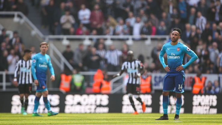 Arsenal's Pierre-Emerick Aubameyang reacts to Matt Ritchie's winning goal for Newcastle