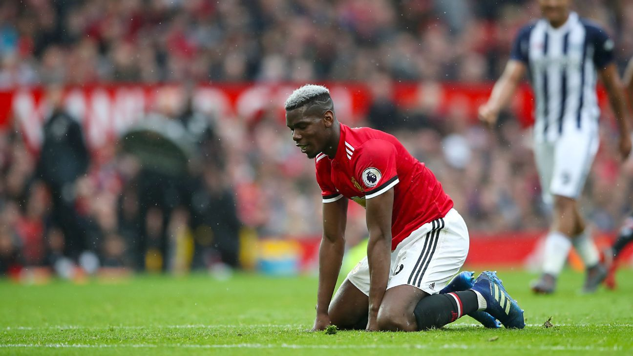 Manchester United's Paul Pogba on his knees against West Brom