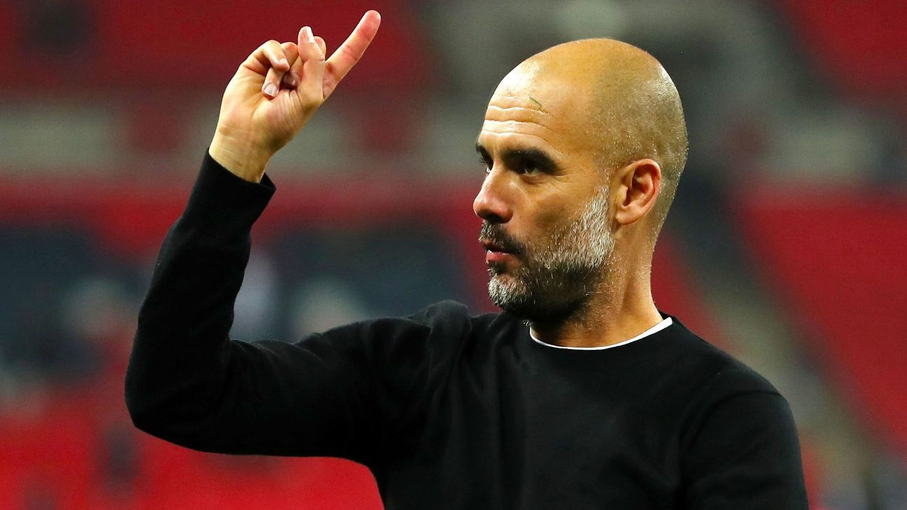 LONDON, ENGLAND - APRIL 14: Pep Guardiola the head coach / manager of Manchester City raises his finger to indicate one more game after the Premier League match between Tottenham Hotspur and Manchester City at Wembley Stadium on April 14, 2018 in London,