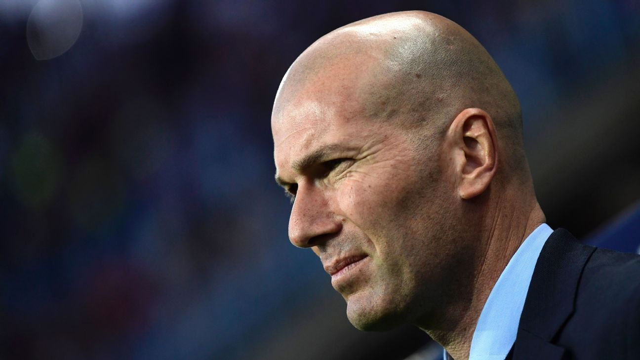 Zinedine Zidane looks on during Real Madrid's La Liga match at Malaga.