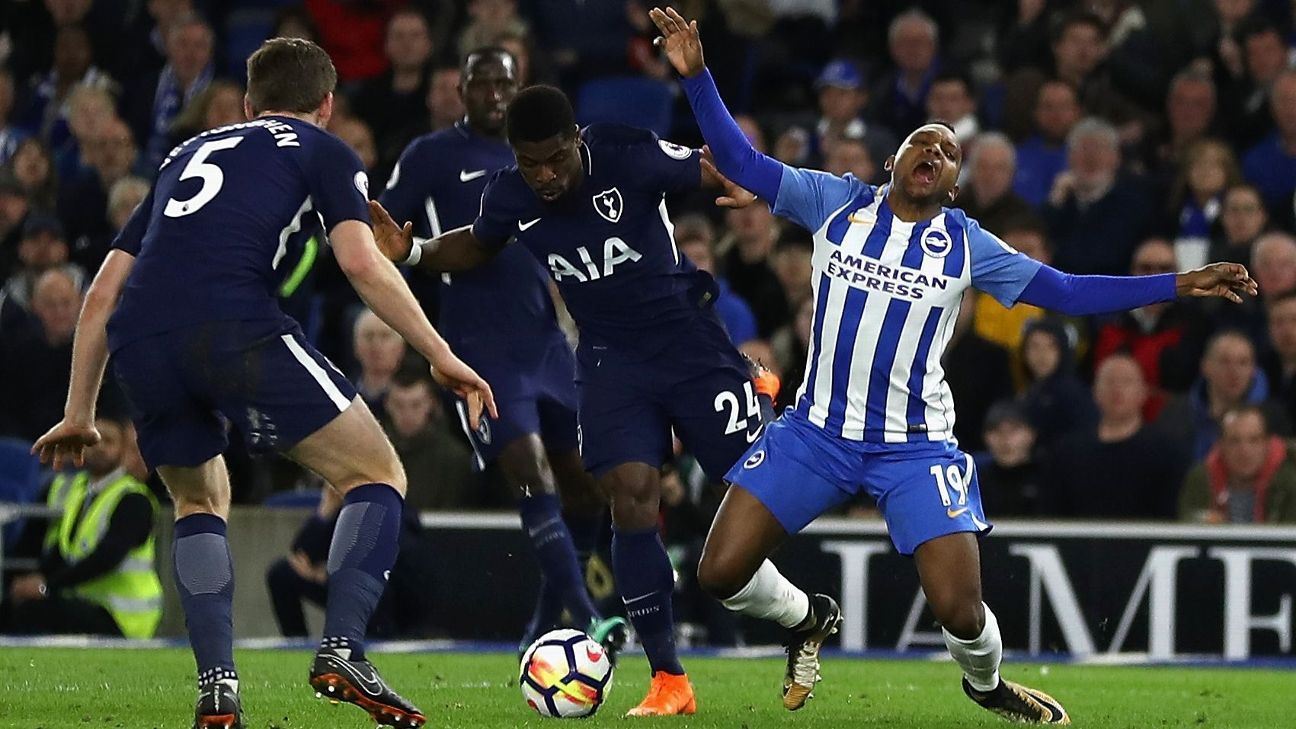 Serge Aurier, centre, gives away a penalty in Tottenham's 1-1 Premier League draw at Brighton.