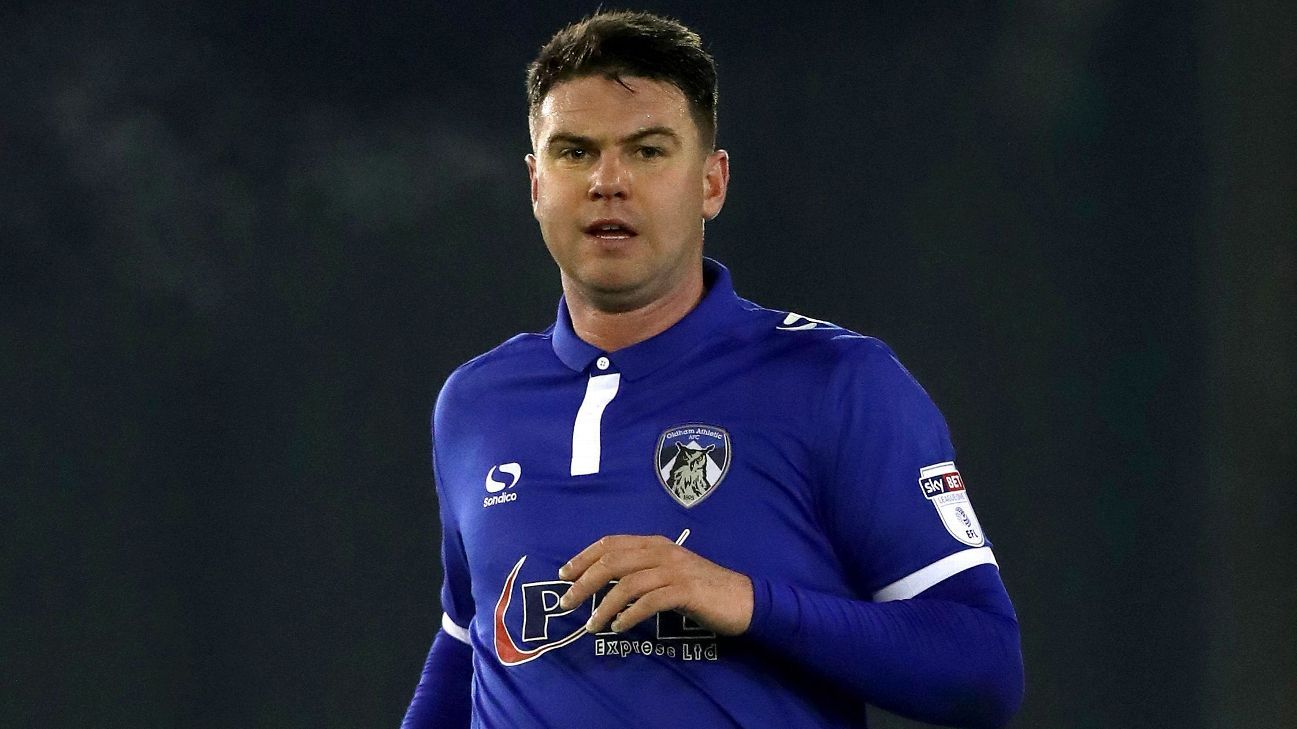 Anthony Gerrard was on hand to stop a fan from confronting the referee in Oldham's League One game against Rochdale.
