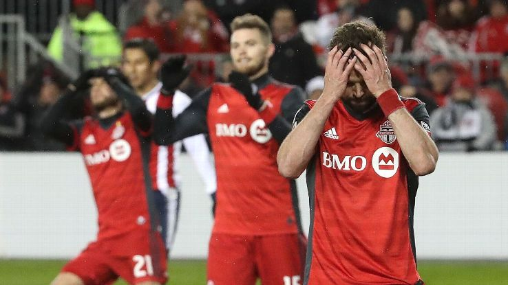 Toronto FC defender Drew Moor reacts after narrowly missing a header.