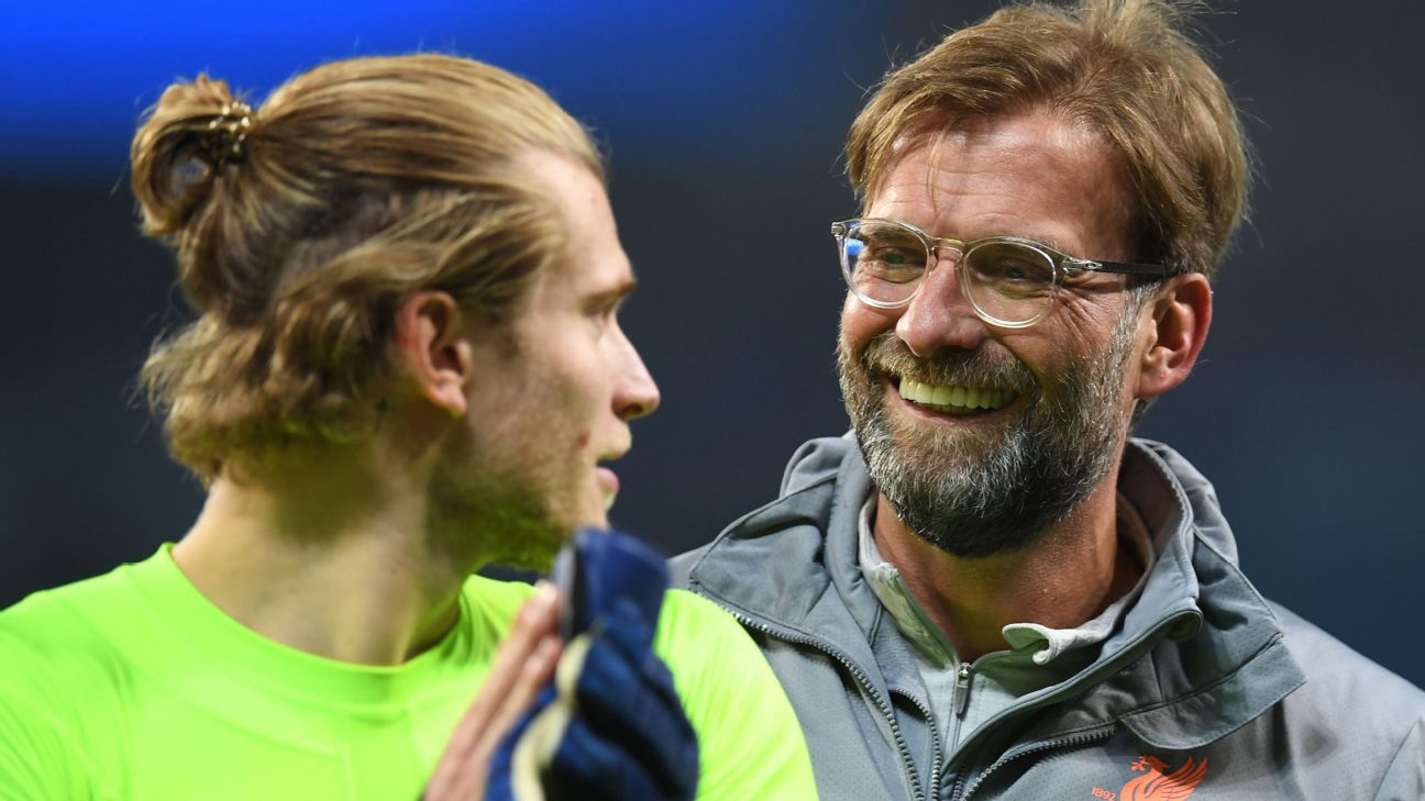 Liverpool's Loris Karius, left, and manager Jurgen Klopp