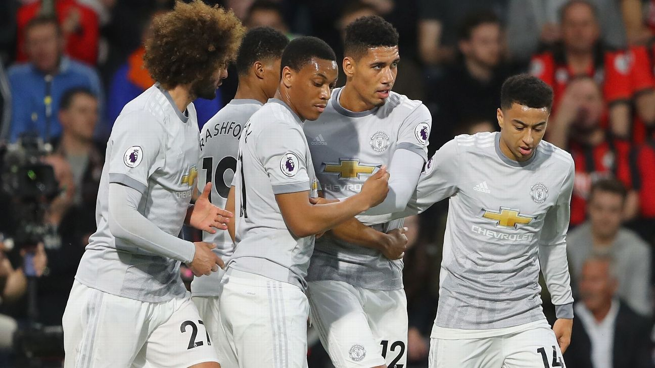 Man United celebrate Chris Smalling's opener.