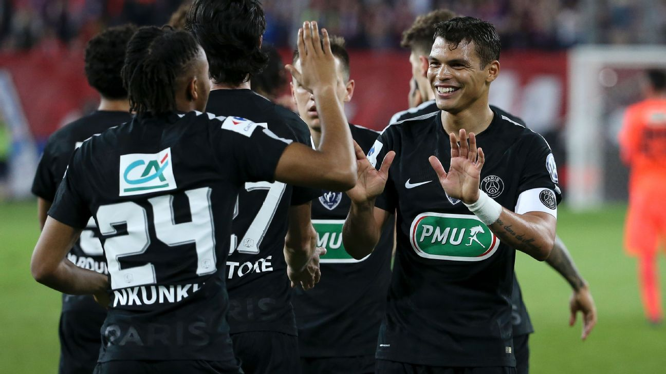 Thiago Silva celebrates with PSG teammates during a 3-1 win against Caen in the Coupe de France.