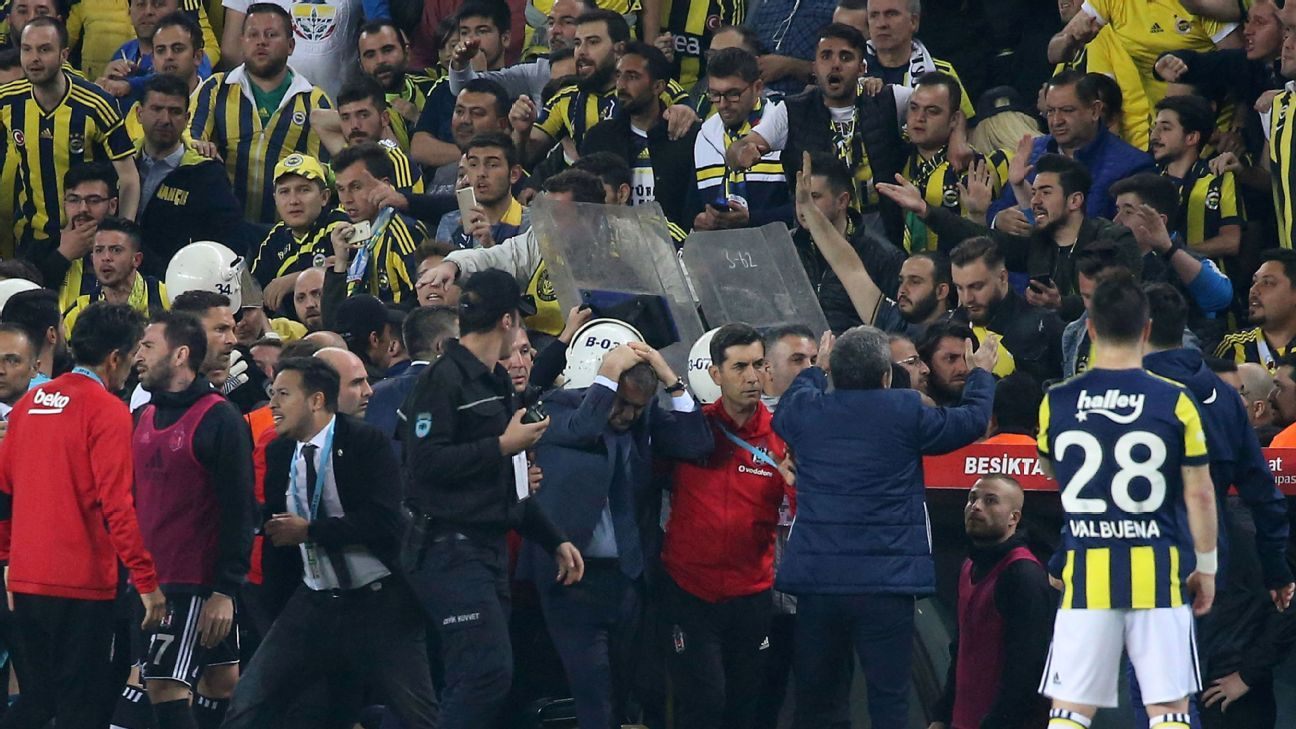 Senol Gunes (holding his head) was injured by an object thrown from the stands.