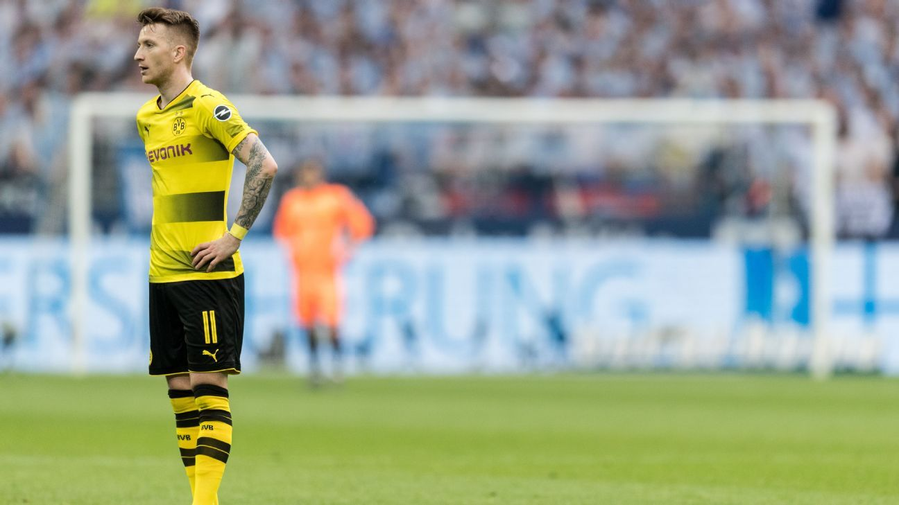 Marco Reus looks on during Borussia Dortmund's derby defeat to Schalke.