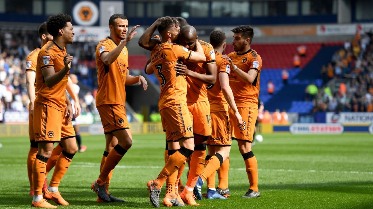 Wolves players celebrate Barry Douglas' goal during their Championship game against Bolton.