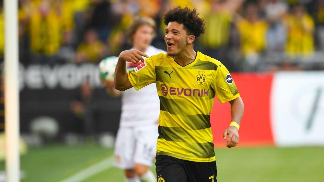Jadon Sancho celebrates after scoring for Borussia Dortmund against Bayer Leverkusen.