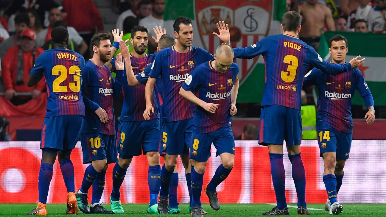 Barcelona players celebrate after scoring the opening goal against Sevilla in the Copa del Rey.