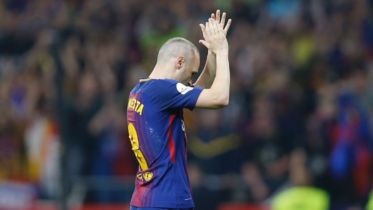 Andres Iniesta applauds to the fans after exiting Barcelona's Copa del Rey win against Sevilla.