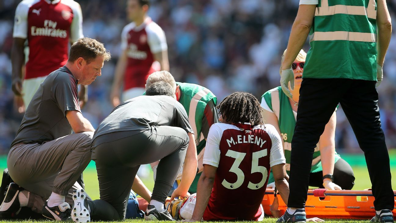 Mohamed Elneny receives treatment after picking up an injury during Arsenal's Premier League game against West Ham.