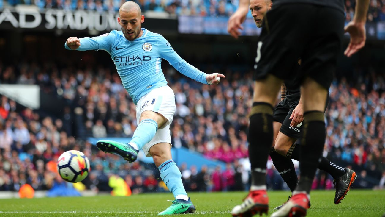 David Silva scores Manchester City's opening goal during their Premier League game against Swansea.