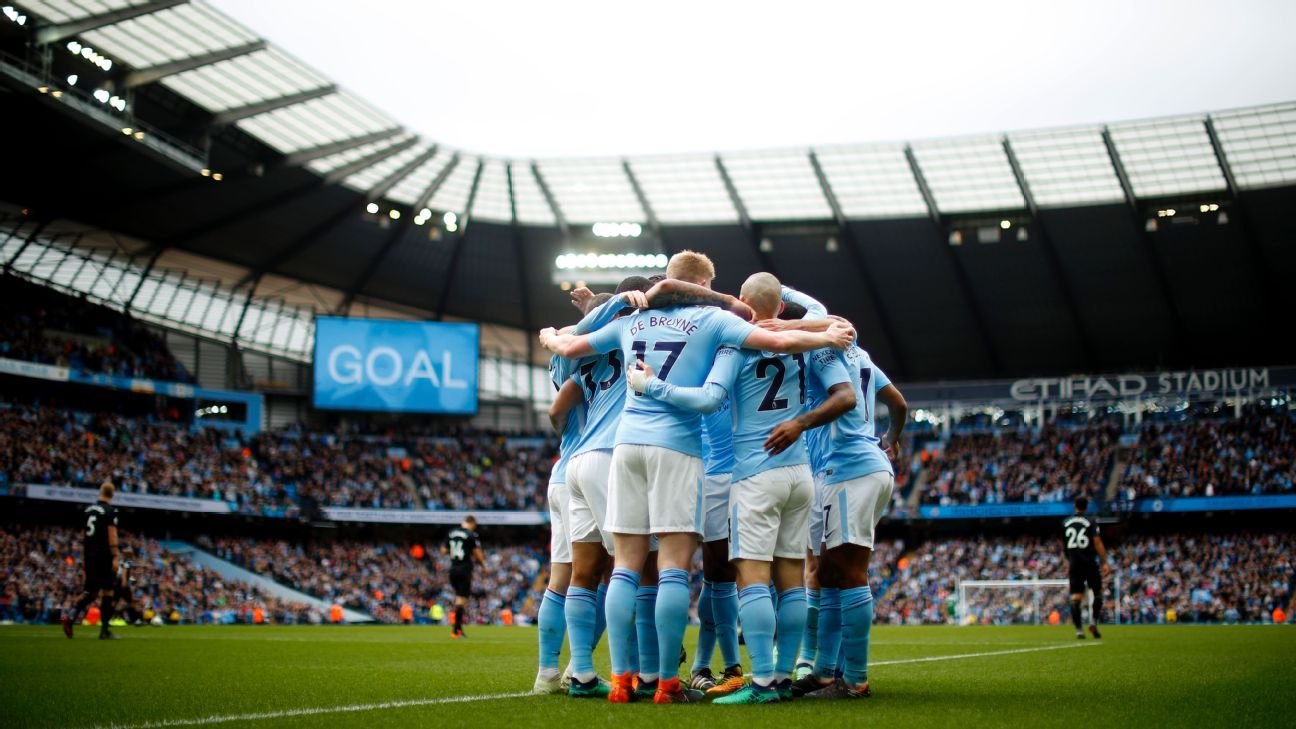 Manchester City players celebrate David Silva's goal during their Premier League game against Swansea.