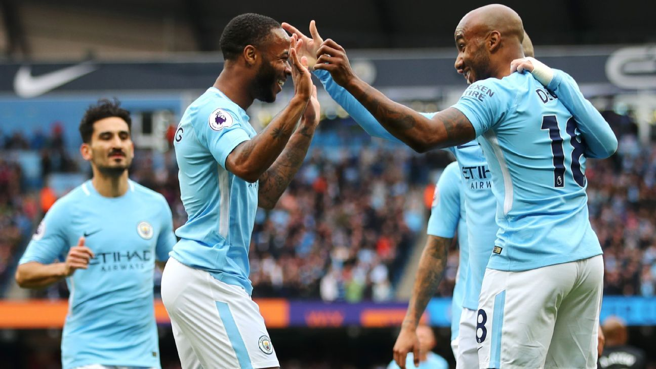 Raheem Sterling celebrates after scoring for Manchester City in their Premier League game against Swansea.