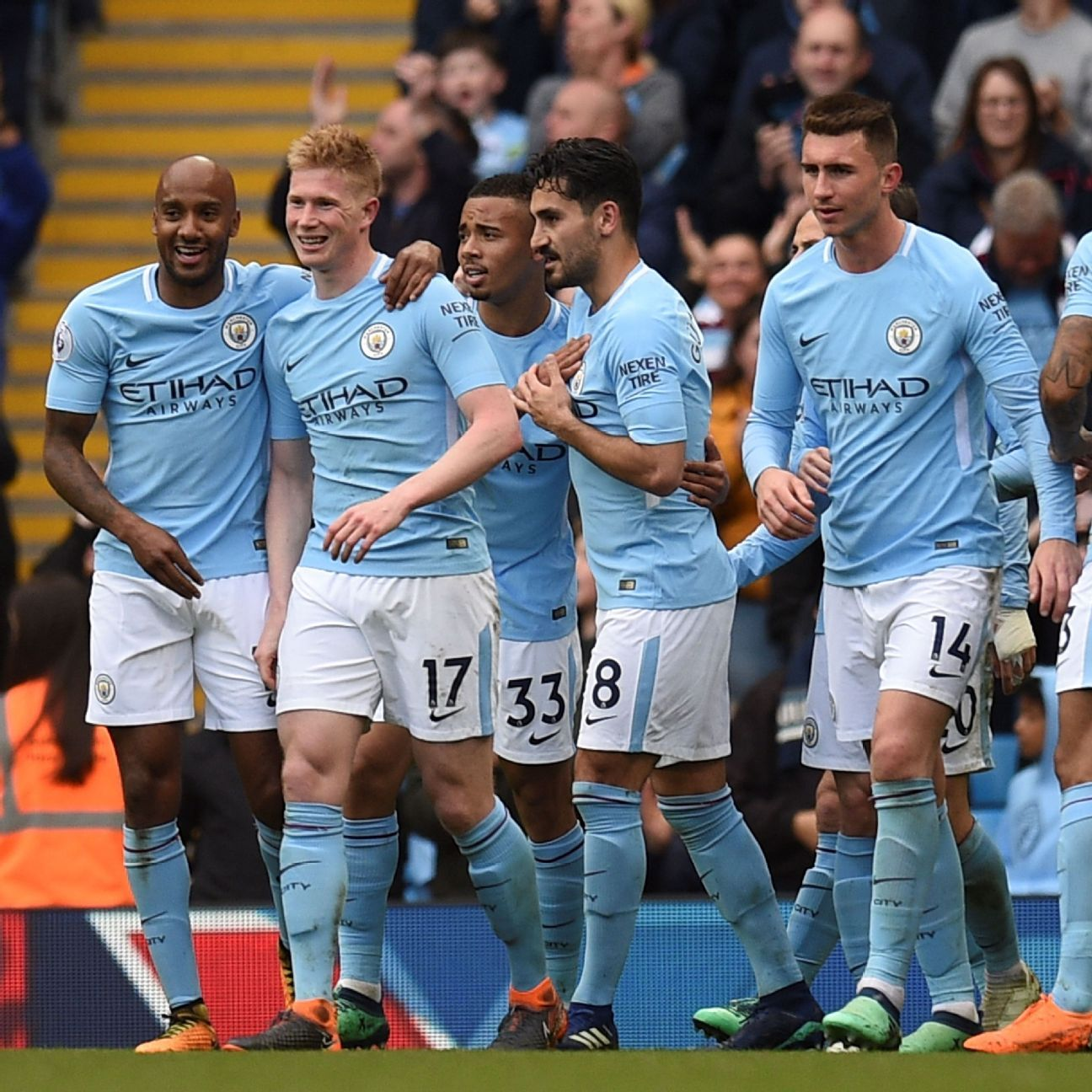 Manchester City players celebrate during their 5-0 Premier League win against Swansea.