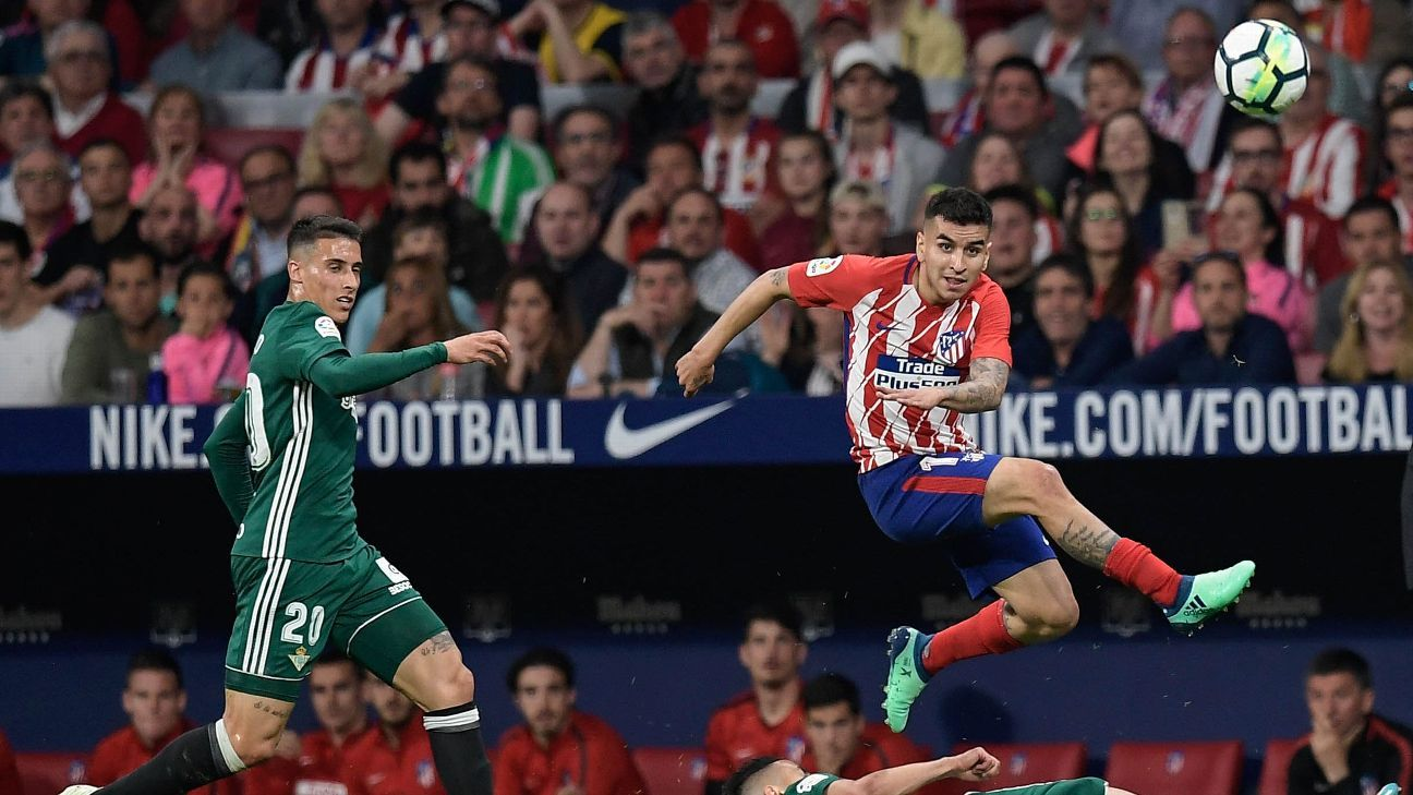 Atletico Madrid's Angel Correa, right, vies with Real Betis' Algerian midfielder Ryad Boudebouz during the teams' 0-0 draw.