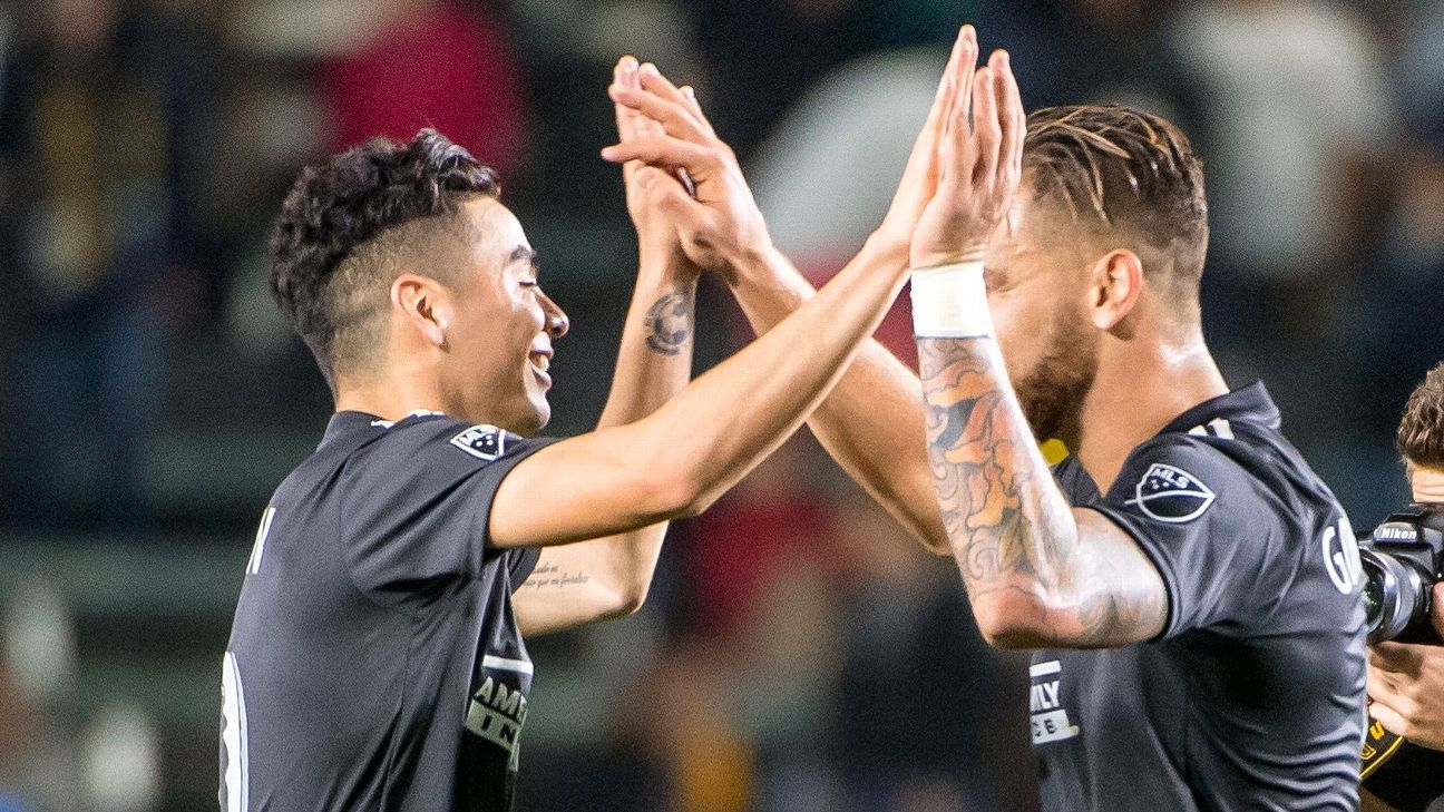 Miguel Almiron #10 and Leandro Gonzalez #5 of Atlanta United celebrate the win following the Los Angeles Galaxy's MLS match against Atlanta United FC at the StubHub Center on April 21, 2018 in Carson, California.
