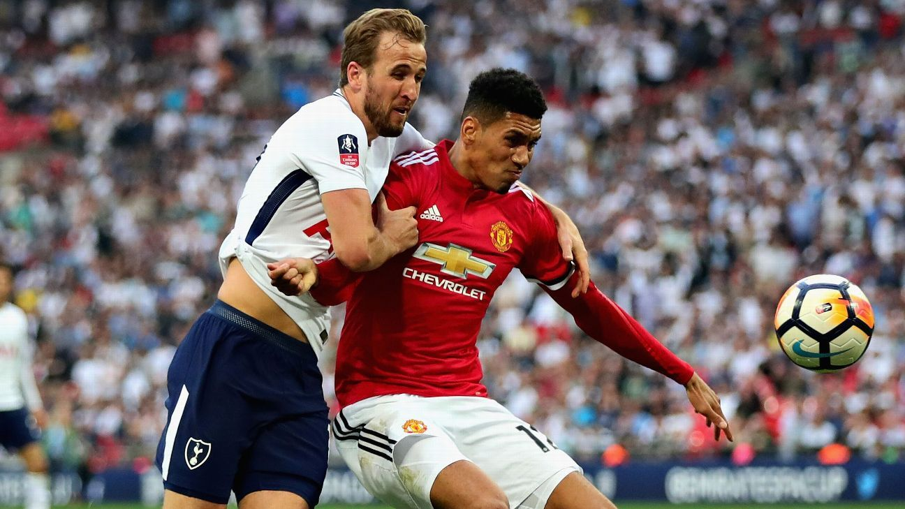 Tottenham's Harry Kane and Manchester United's Chris Smalling battle for the ball during FA Cup semifinal