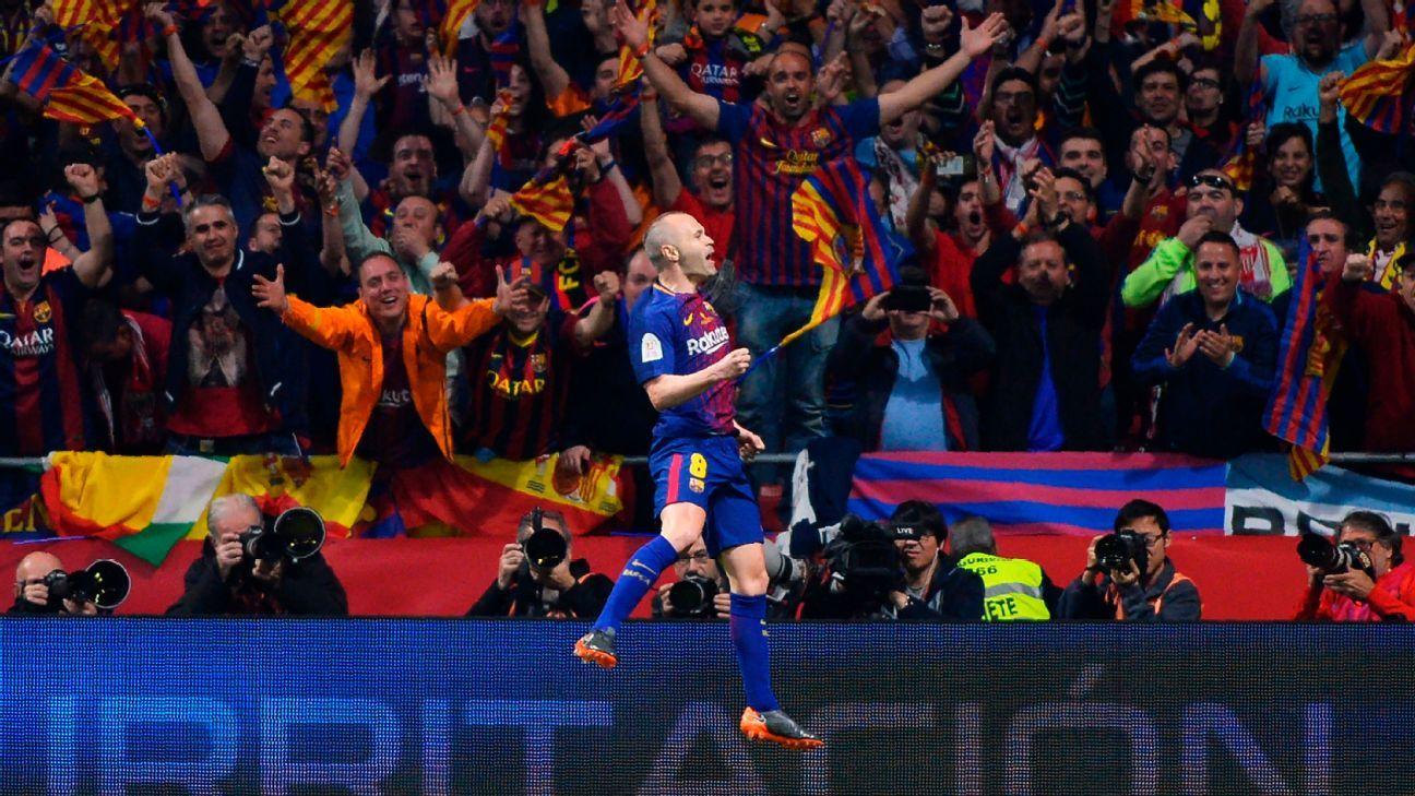 Andres Iniesta celebrates scoring in Barcelona's Copa del Rey final win over Sevilla.