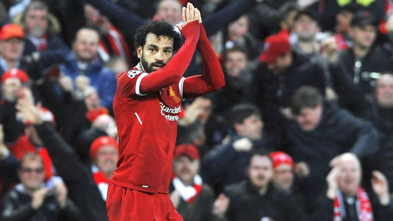 Mohamed Salah celebrates one of his two goals against ex-club Roma.