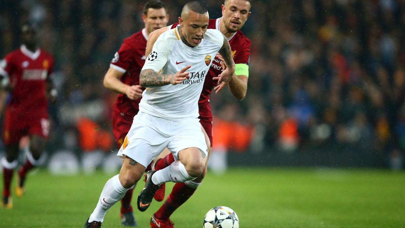 Liverpool's Jordan Henderson, left, chases down Roma's Radja Nainggolan in their Champions League clash at Anfield.
