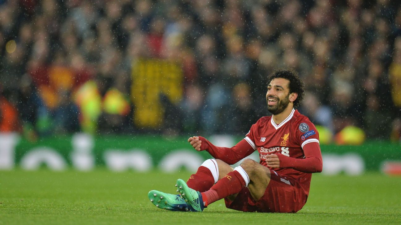 Liverpool's Mohamed Salah reacts after being fouled in their Champions League match against Roma.