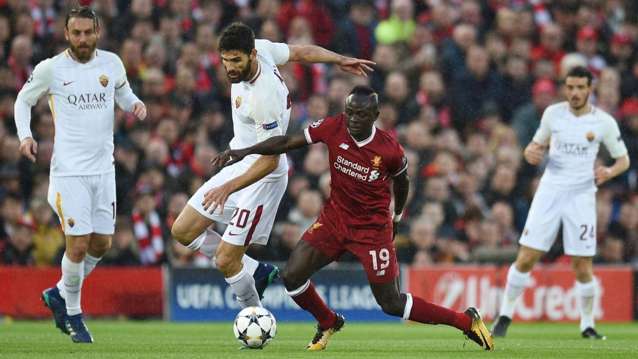 Liverpool's Sadio Mane and Roma's Federico Fazio battle for the ball in their Champions League semifinal at Anfield.
