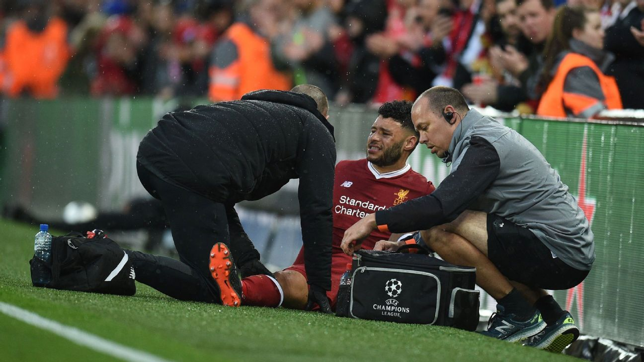 Liverpool's English midfielder Alex Oxlade-Chamberlain receives treatment after sustaining an injury against Roma.