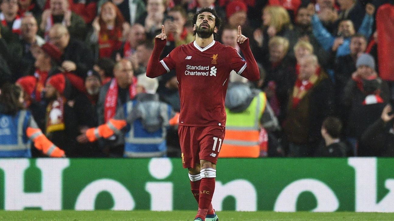 Liverpool's Mohamed Salah celebrates after scoring against Roma in the Champions League.