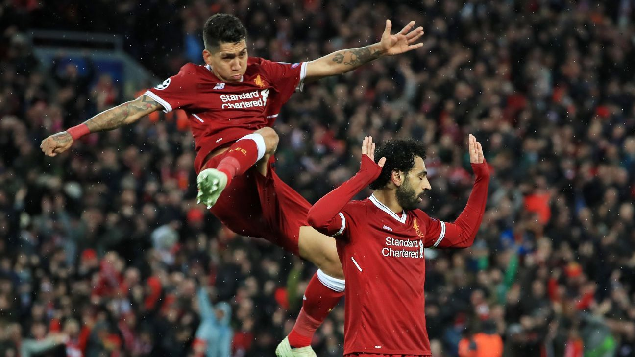 Roberto Firmino, left, celebrates with Mohamed Salah after a Liverpool goal against Roma.