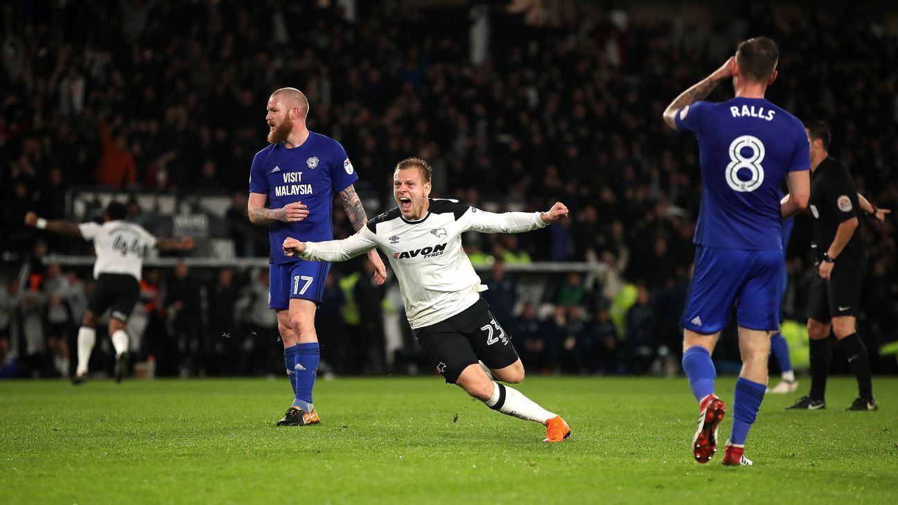 Derby County's Matej Vydra (centre) celebrates scoring his side's second goal of the game against Cardiff City.
