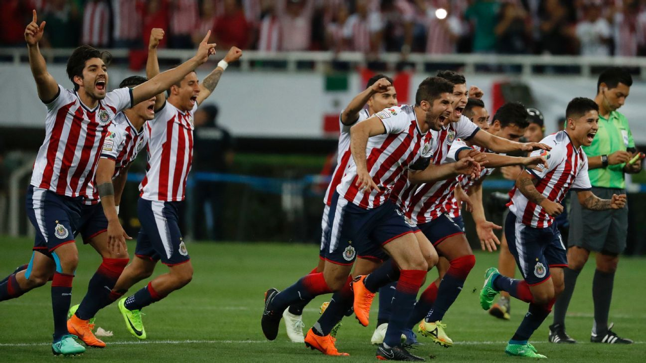 Chivas players celebrate their victory over Toronto FC after a penalty shoot out in the CONCACAF Champions League final.