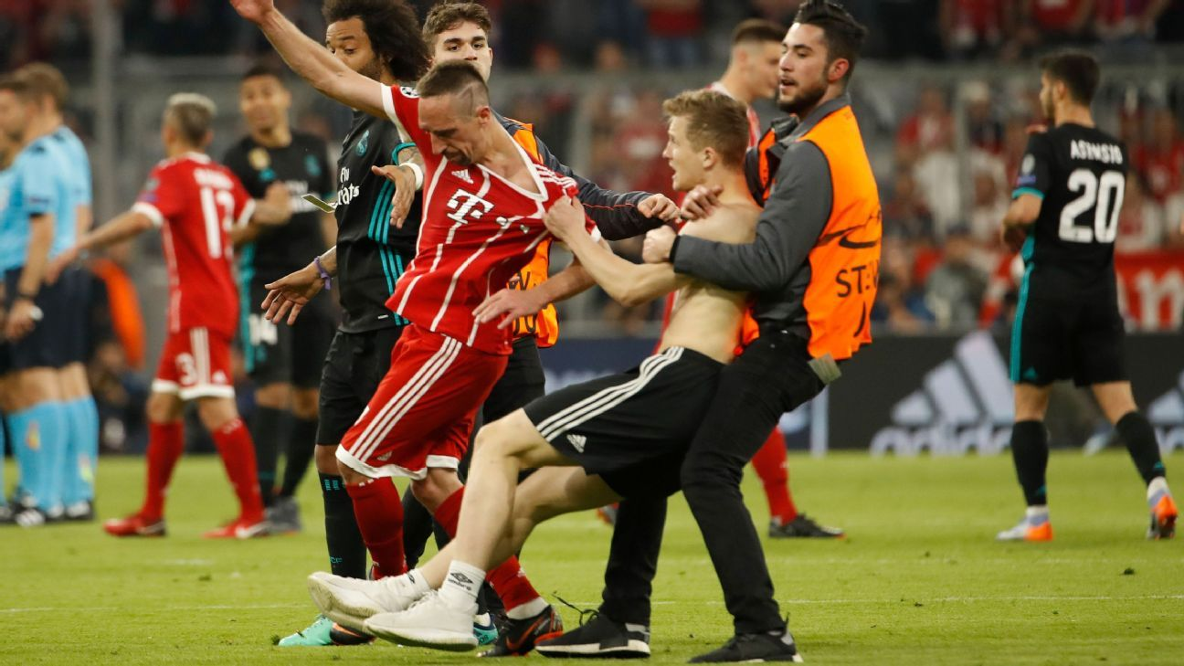 Pitch invader grabs Franck Ribery during Bayern Munich vs Real Madrid
