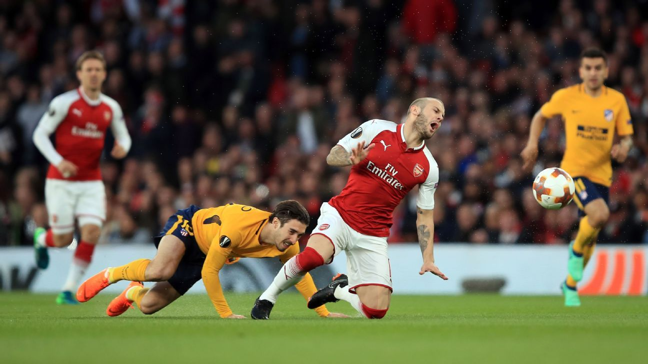 Sime Vrsaljko tackles Jack Wilshere during the Europa League match between Arsenal and Atletico Madrid.