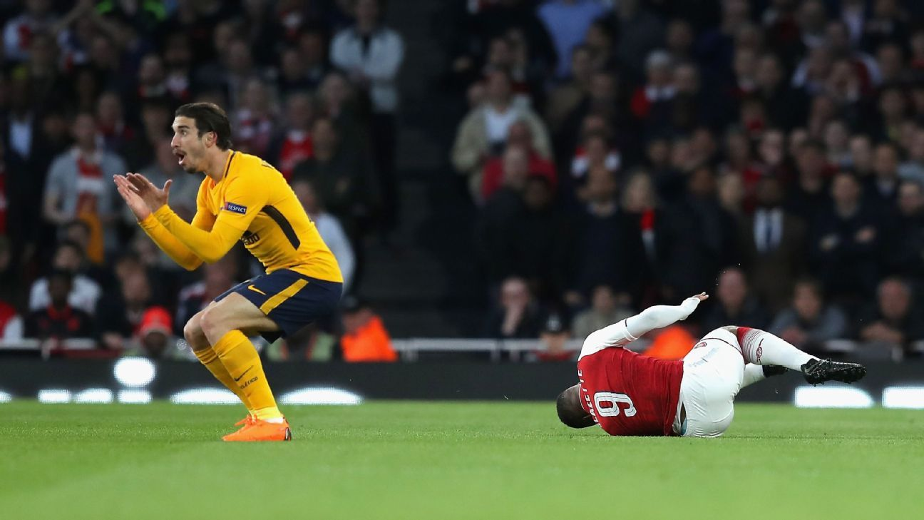 Sime Vrsaljko reacts after fouling Alexandre Lacazette in the Europa League match between Arsenal and Atletico Madrid.