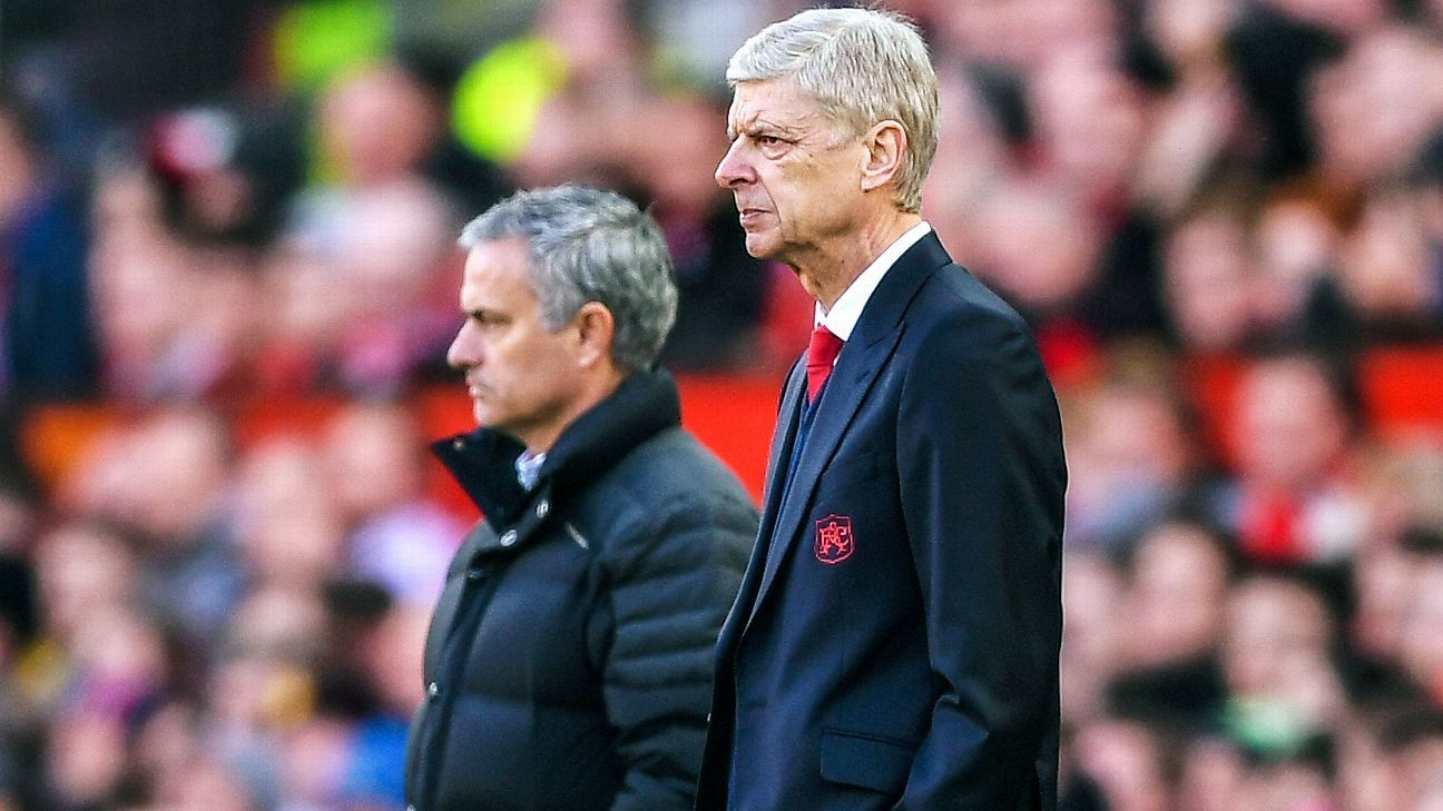 Arsene Wenger, fore, and Jose Mourinho look on during a match between Arsenal and Manchester United.