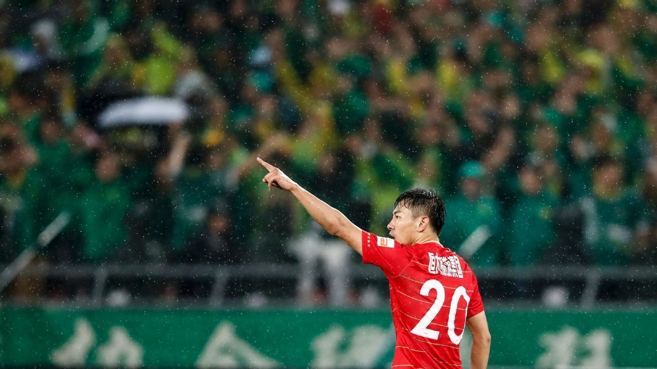 Yu Hanchao celebrates scoring during Guangzhou Evergrande's match against Beijing Guoan.