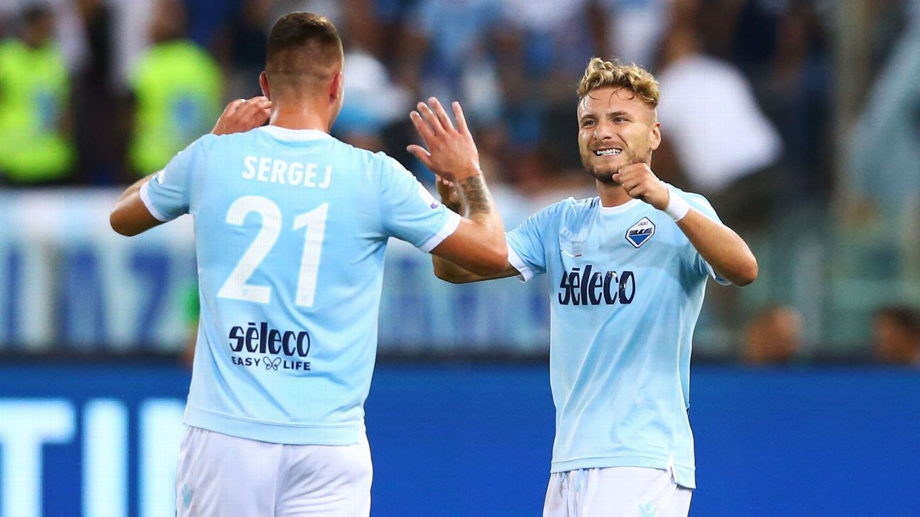 Sergej Milinkovic-Savic and Ciro Immobile celebrate during the Italian Super Cup match between Lazio and Juventus.