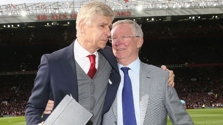 Arsene Wenger and Sir Alex Ferguson embrace.