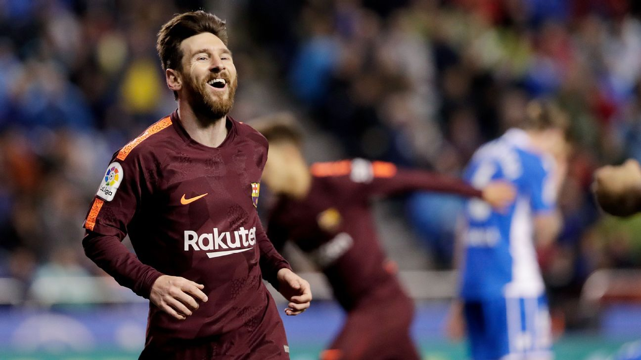 Lionel Messi celebrates scoring during Barcelona's win at Deportivo La Coruna.