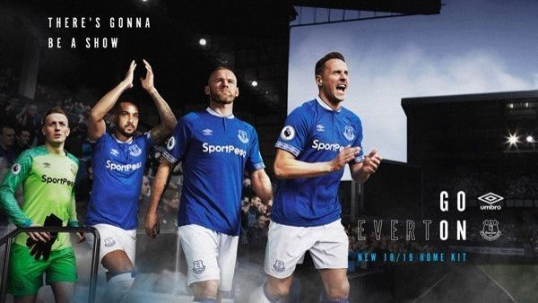 Jordan Pickford, Theo Walcott, Wayne Rooney and Phil Jagielka model Everton's 2018-19 kit