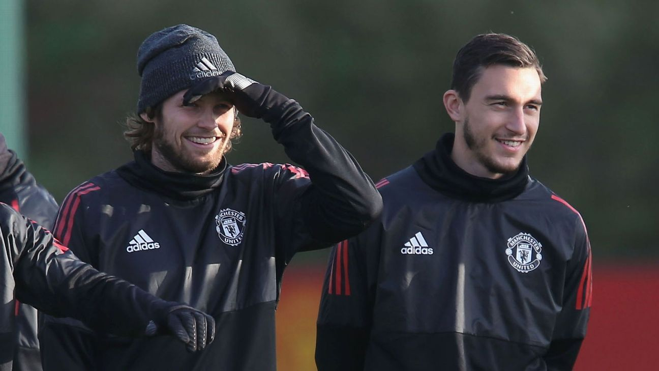 Manchester United's Daley Blind, left, and Matteo Darmian