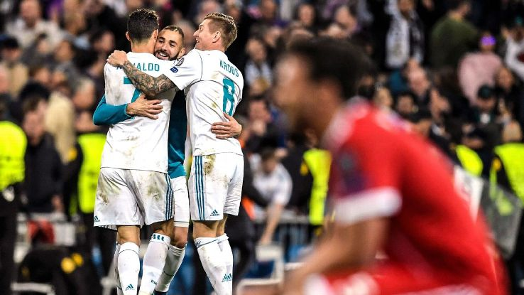 Cristiano Ronaldo, Karim Benzema and Toni Kroos celebrate after Real Madrid reach the Champions League final.