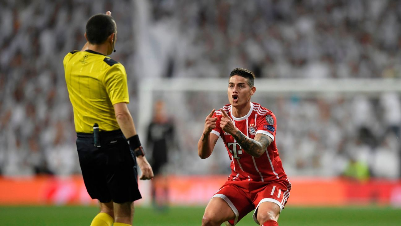 Referee Cuneyt Cakir and Bayern Munich's James Rodriguez during Champions League final s Real Madrid