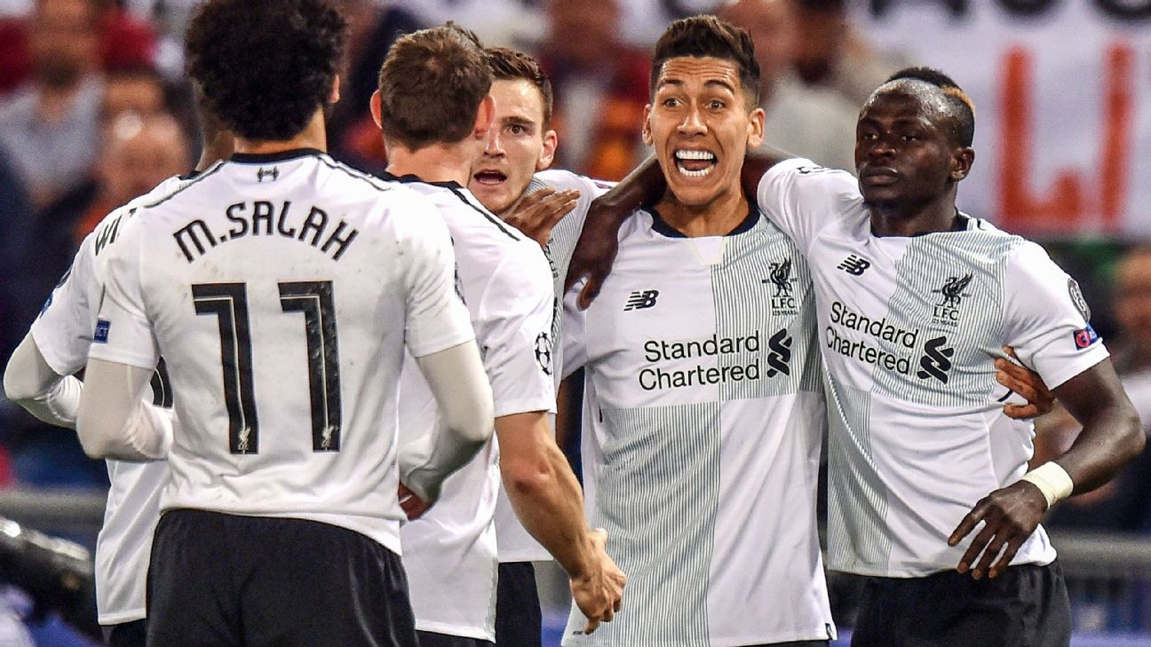 Sadio Mane, far right, celebrates scoring in Liverpool's Champions League match at Roma.