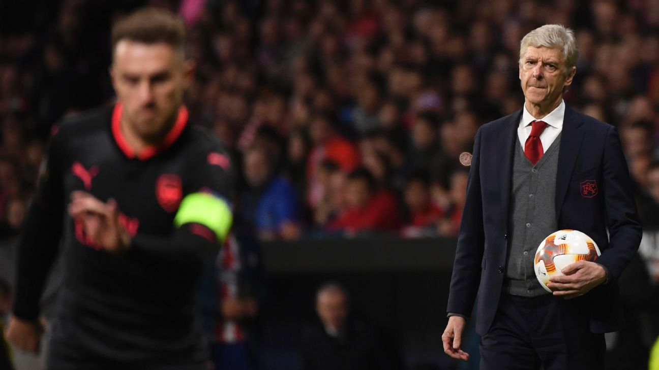 Arsene Wenger looks on during Arsenal's Europa League loss at Atletico Madrid.