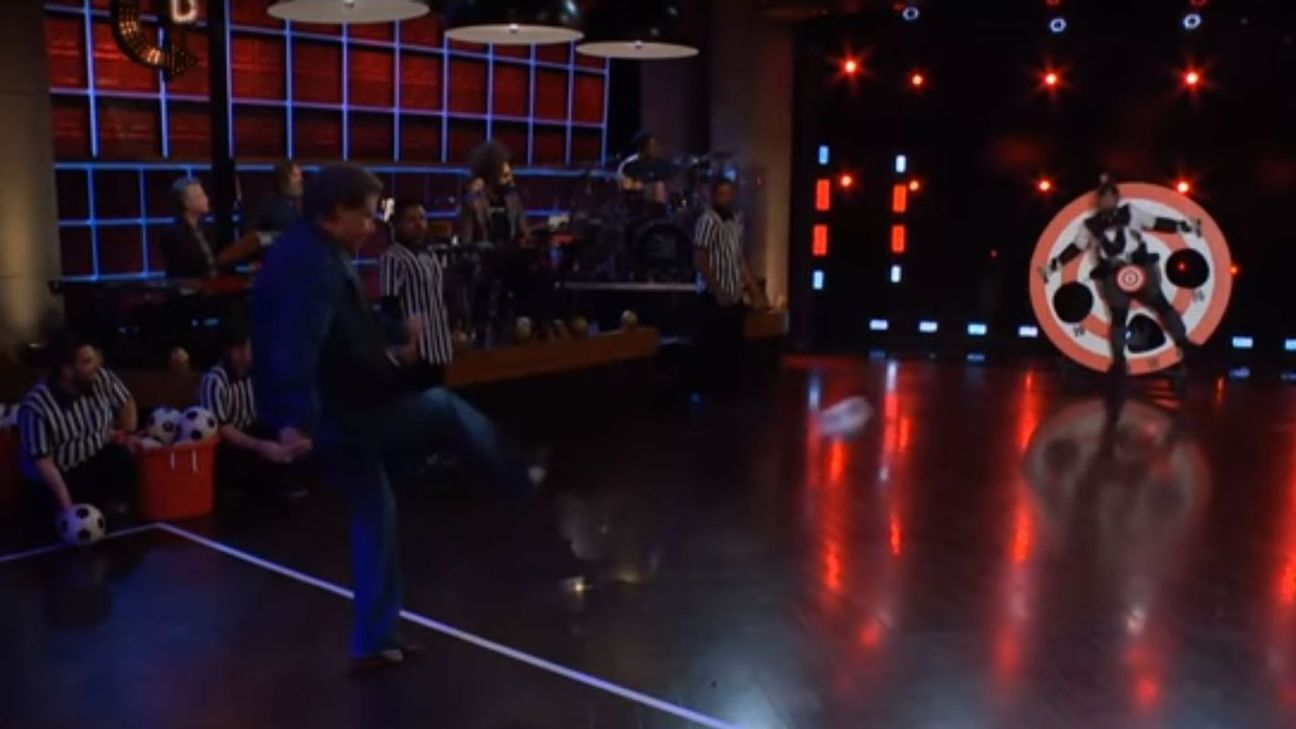 Will Ferrell uses James Corden as target practice