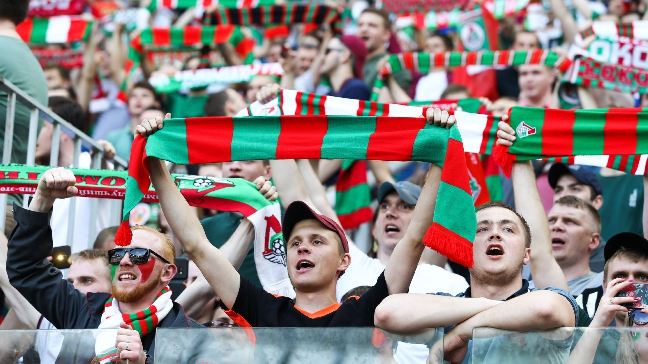 Lokomotiv Moscow fans celebrate during their team's 1-0 against Zenit that secured the Russian Premier League title.